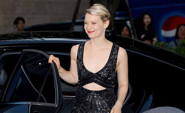 Mia Wasikowska getting out of her car.