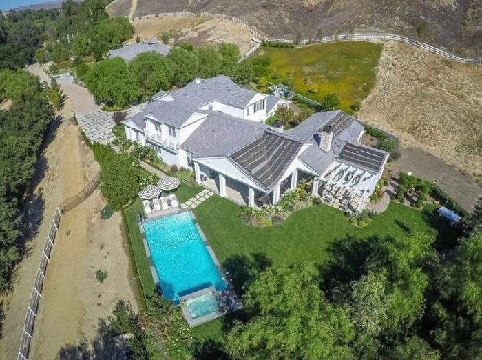 Blac Chyna mansion from top view with a swimming pool which in on a green garden