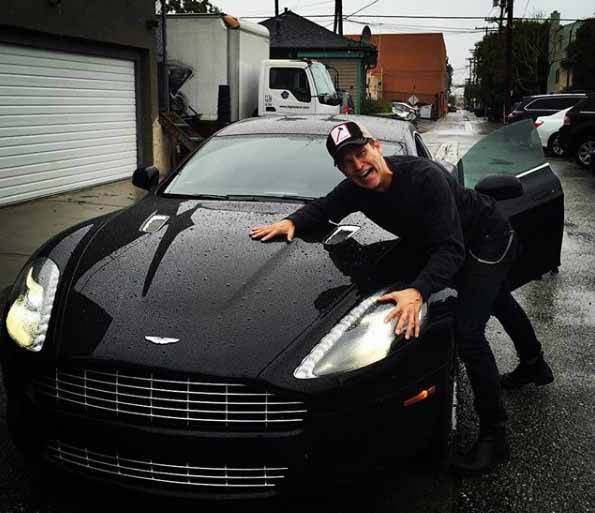 Stephen Moyer taking a picture with car.
