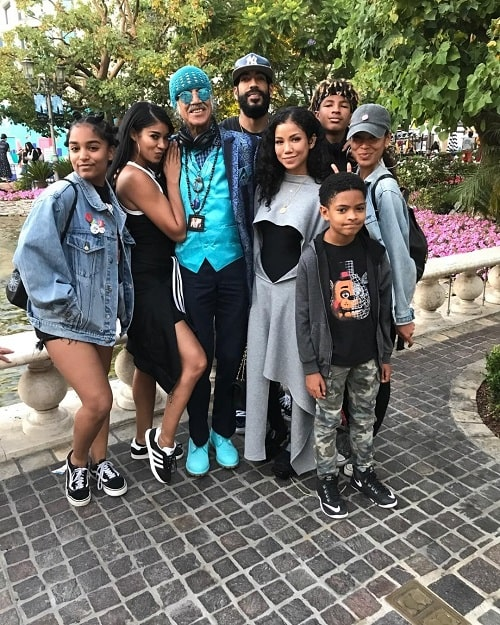 A picture of Christina's kids and grand-children with Dr. Karamo Chilombo.