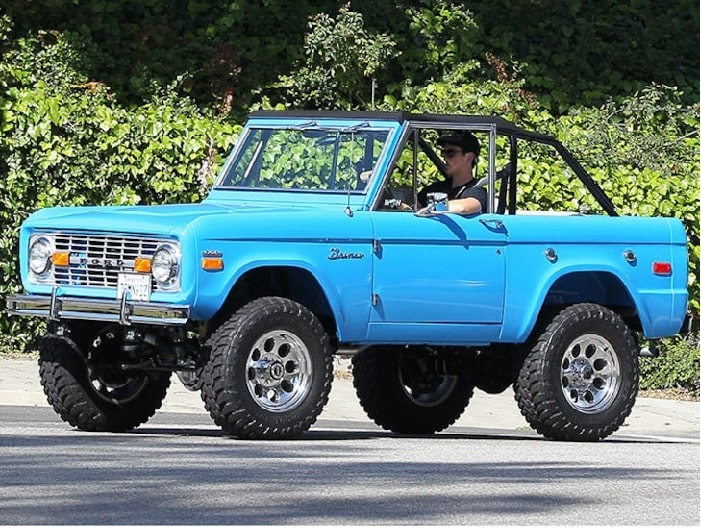 Miles Teller driving his blue Ford Bronco