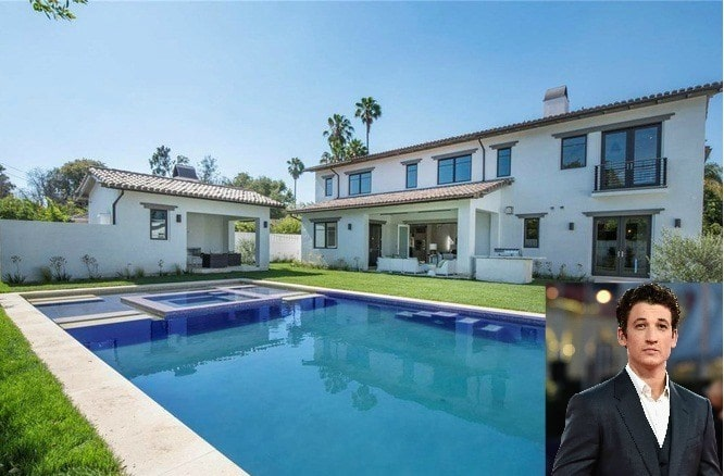 Miles Teller mansion with a large swimming pool in front of his house