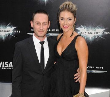 Josh Stewart and his ex-wife Deanna Brigidi taking picture together.