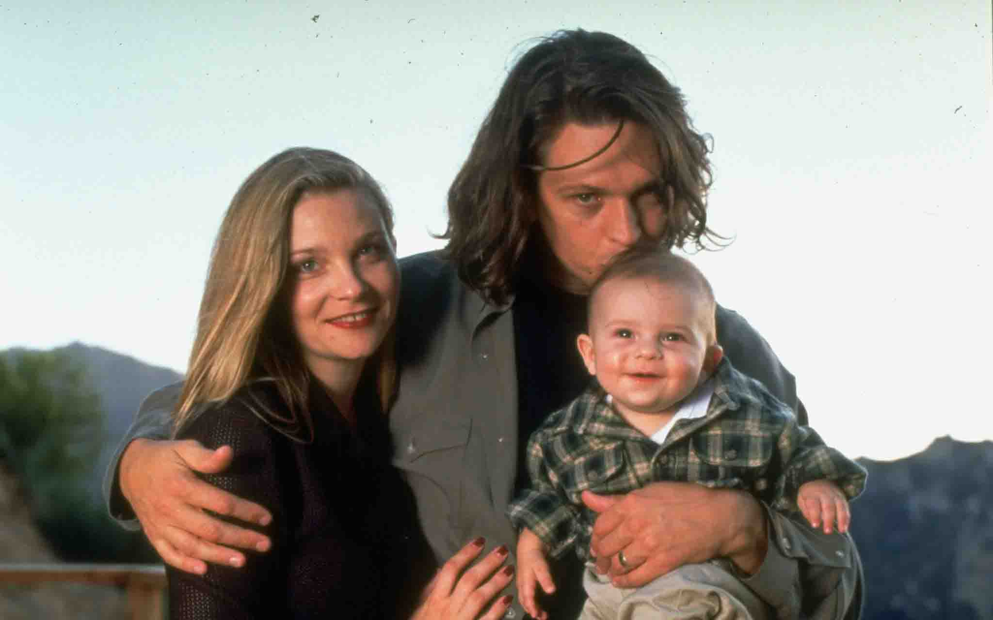 Jimmy McNichol with his wife and son.