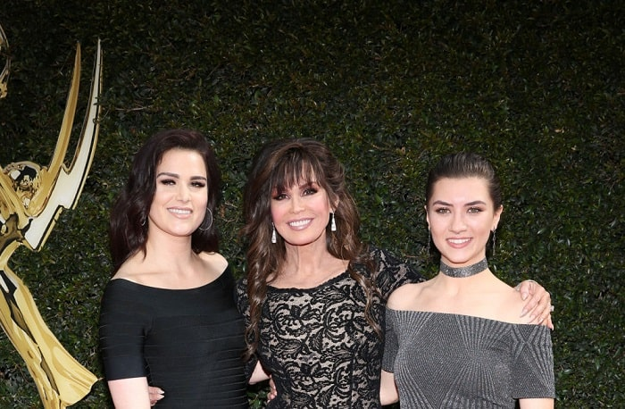 Brian's beautiful ex wife and his two daughters.