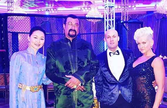 Erdenetuya Seagal poses for a picture with her husband and friends.