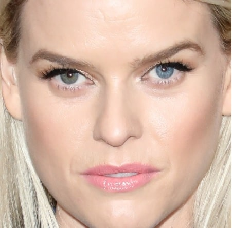 A picture of Alice Eve with two different eye color.
