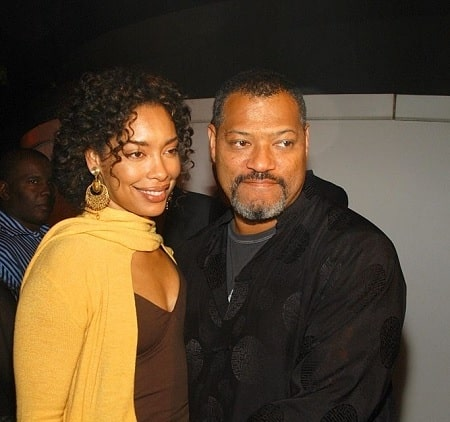 A picture of Langston's parents: Laurence Fishburne and his ex-wife, Hajna O. Moss.