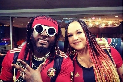A picture of Amber Najm with her husband, T-Pain.