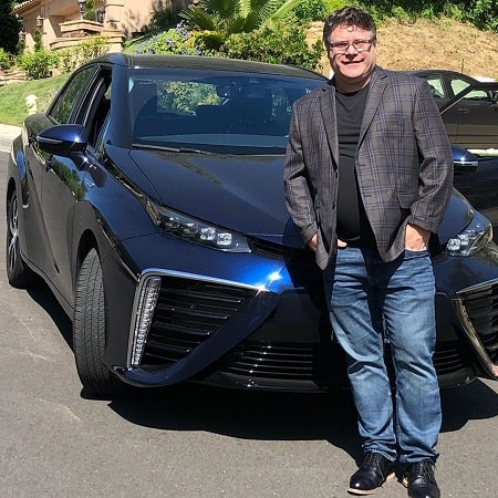 A picture of Sean Astin with his Toyota FCV car.