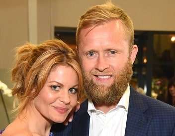A picture of Former Russian ice hockey player, Valeri Bure and his wife, actress Candace Cameron.