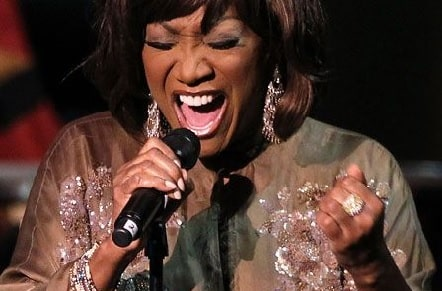 A picture of Patti Labelle singing.