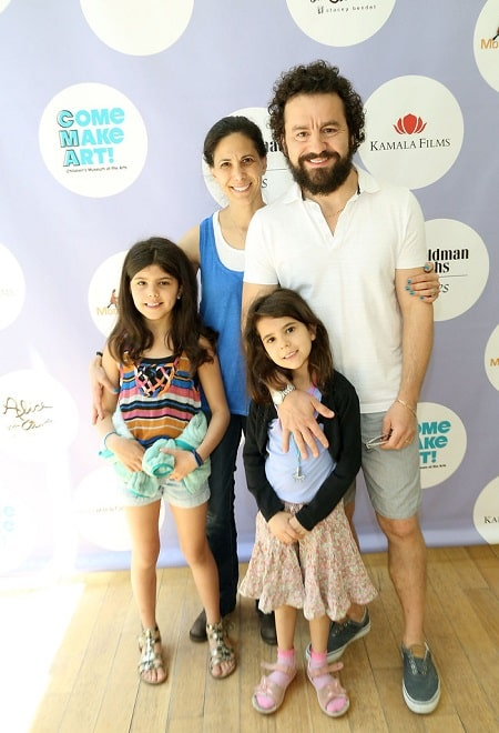 A picture of Max Casella with his wife and daughters.