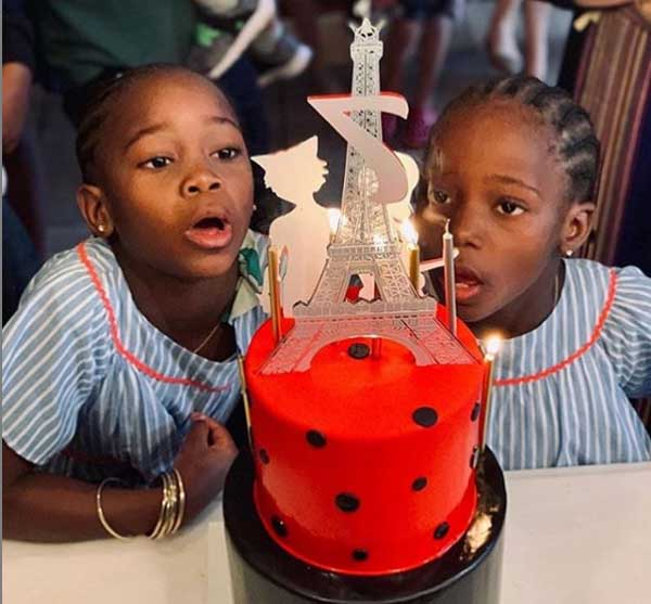 Ciccone twins taking a photo with their birthday cake