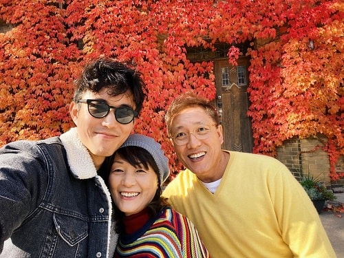 A picture of Justin H. Min with his parents in Toronto.