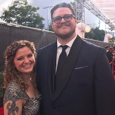 A picture of Cameron Britton with his wife at the Emmys.