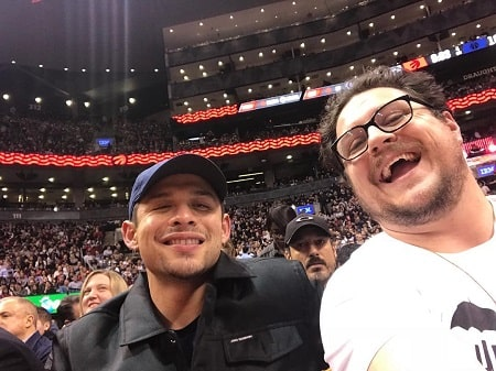 A picture of David Castaneda with his his co-star, Cameron Britton.