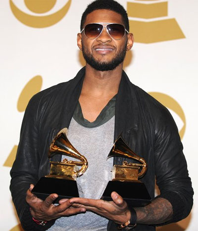 A photo of Usher showing his Grammy.