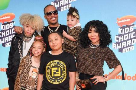 A photo of TI with his wife and children.