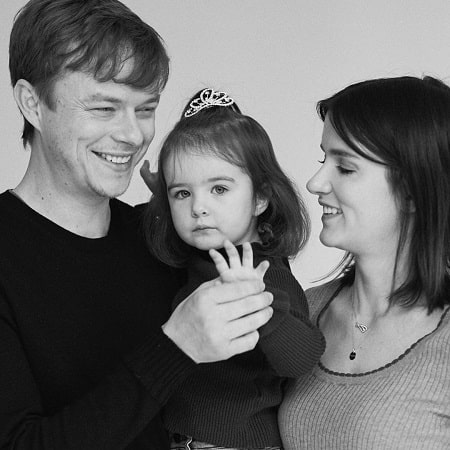 A picture of DeHaan family where Bowie Rose DeHaan is showing four finger where they soon will be four family members.