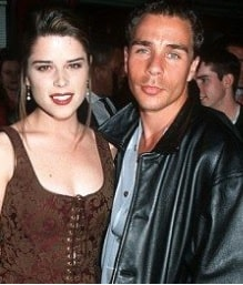 A picture of Neve Campbell with Jeff Colt.