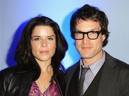 A picture of Neve Campbell with John Light.