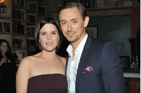 A picture of Caspian Feild parents JJ Feild and Neve Campbell.