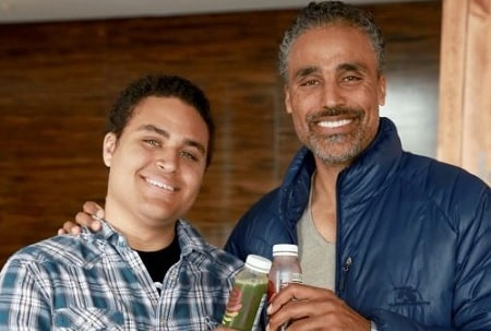 A picture of Kyle Fox with his father, Rick Fox.