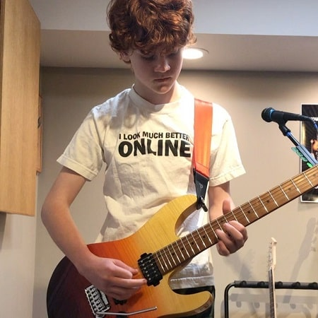 A picture of Kyle Harrison Breitkopf playing electric guitar.