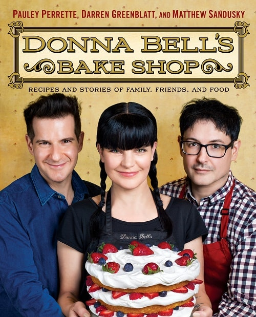 Pauley Perrette with on the cover picture of her book Donna Bell's Bake Shop with her best friends.