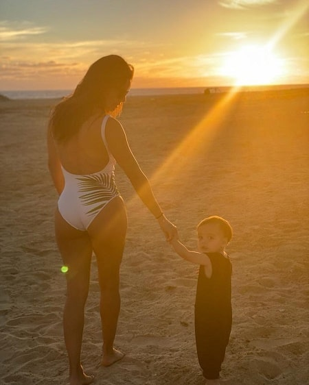 Santiago Enrique Bastón with his mother Eva Longoria watching the sunset.